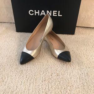 Chanel size 5 gold/black leather cap-toe flats.